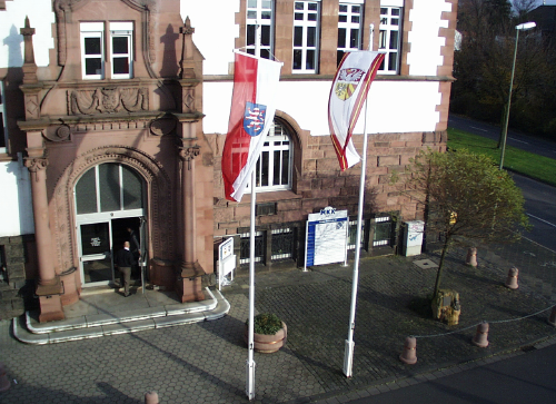 the Main entrance of the district office Hanau, with forecourt and flags