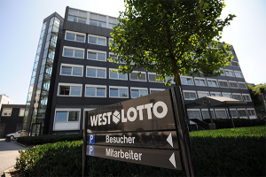 Westlotto Headquarter with a sign and a tree
